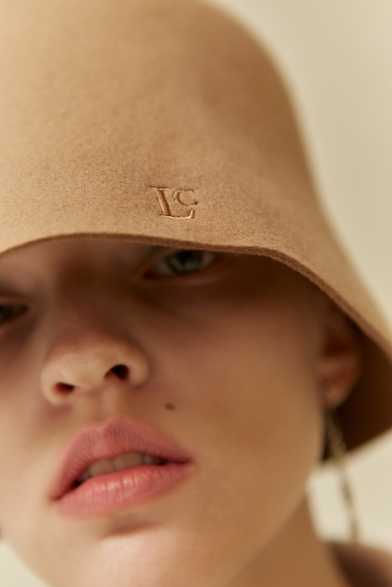 <u>SHOP</u><br>19 WINTER LOCLE Lambs Wool Bucket Hat - beige
